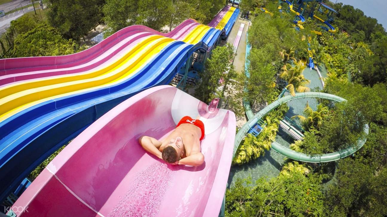 person sliding down a water slide